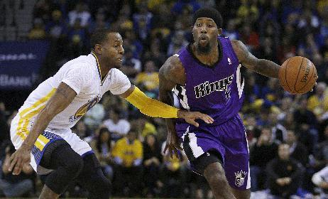 Sacramento Kings' John Salmons, right, drives the ball past Golden State Warriors' Andre Iguodala during the first half of an NBA basketball game on Saturday, Nov. 2, 2013, in Oakland, Calif