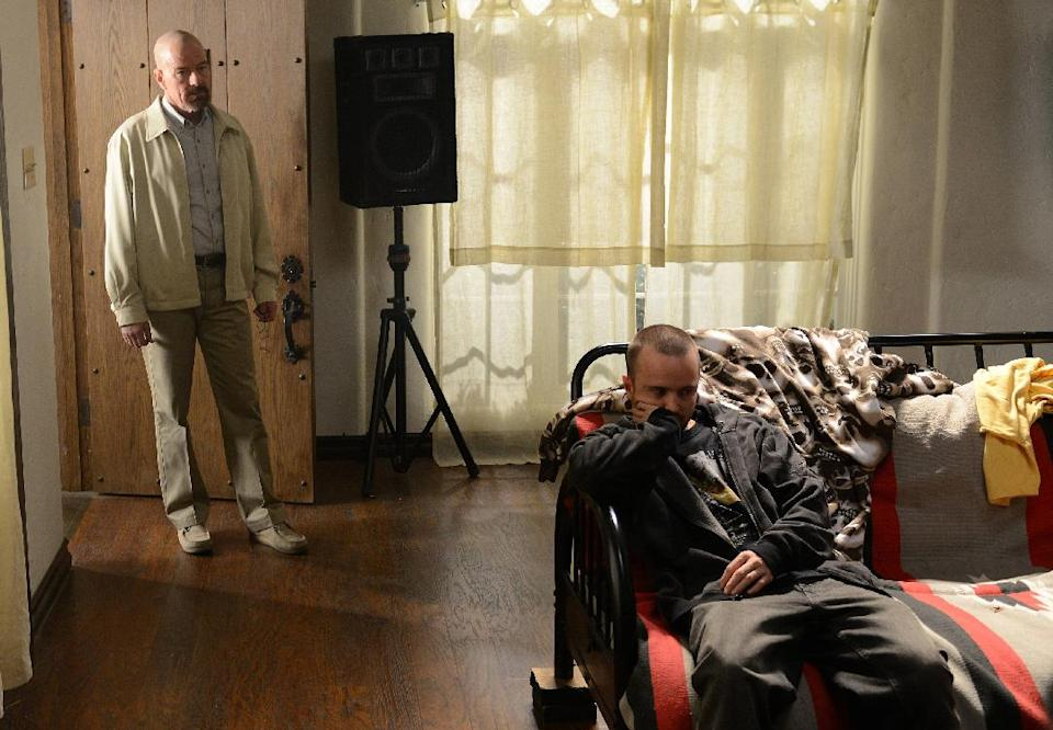 "This TV publicity image released by AMC shows Bryan Cranston as Walter White, left, and Aaron Paul as Jesse Pinkman in a scene from ""Breaking Bad."" The final season premiered on Sunday, Aug. 11. (AP Photo/AMC, Ursula Coyote)"