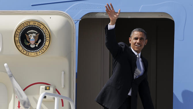 President Barack Obama waves he boards Air Force One before departing for Denver, Wednesday, Oct. 3, 2012, in Las Vegas. Obama will face Republican presidential candidate Mitt Romney tonight in the first of four presidential debates. (AP Photo/Julie Jacobson)