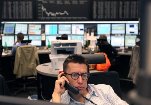 <p>A trader at the Frankfurt stock exchange. Europe's main stock markets slid at the start of trading on Monday, with</p>