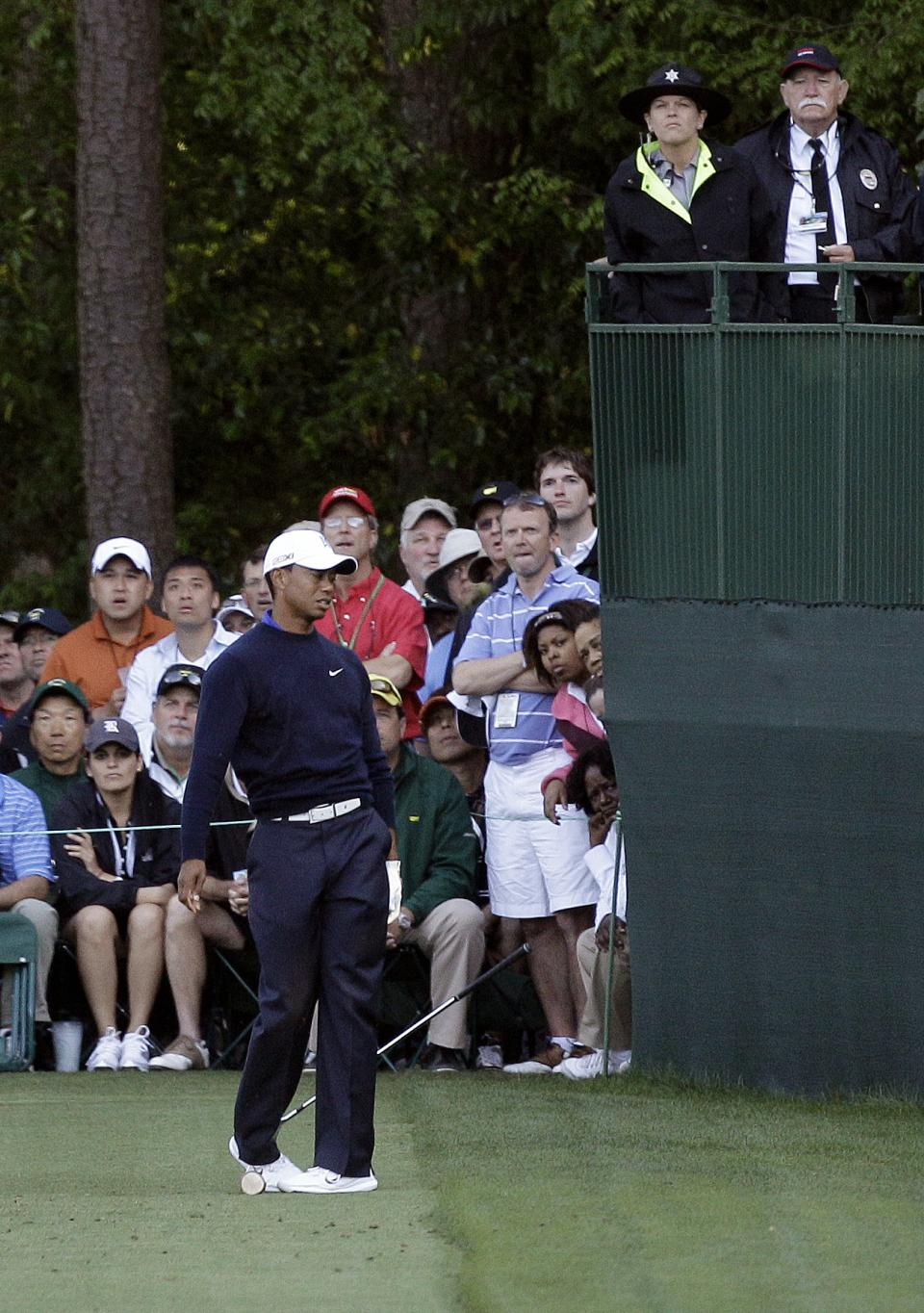 Tiger Woods reacts to his tee shot on the 16th hole during the second round of the Masters golf tournament Friday, April 6, 2012, in Augusta, Ga. (AP Photo/Matt Slocum)