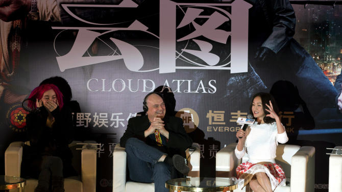 "FILE - In this Jan. 21, 2013 file photo, Lana Wachowski, left,  and Andy Wachowski, center, co-writers and co-directors of ""Cloud Atlas,"" look on as Chinese actress and cast member Zhou Xun, right, speaks during a press conference held ahead of the movie's China premiere in Beijing, China. Nearly 40 minutes has been chopped from China's version of the soon-to-be-released Hollywood film ""Cloud Atlas,"" deleting both gay and straight love scenes to satisfy local censors despite a movie-going public that increasingly chafes at censorship. (AP Photo/Ng Han Guan, File)"