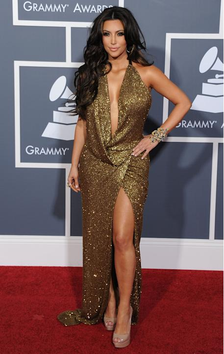 Yes, I'm endorsing Kim Kardashian, who wore this plunging, drapey, liquid gold Kaufman Franco halter gown to perfection. Her massively thick, tousled dark hair, meticulously applied smoky eye-makeup a