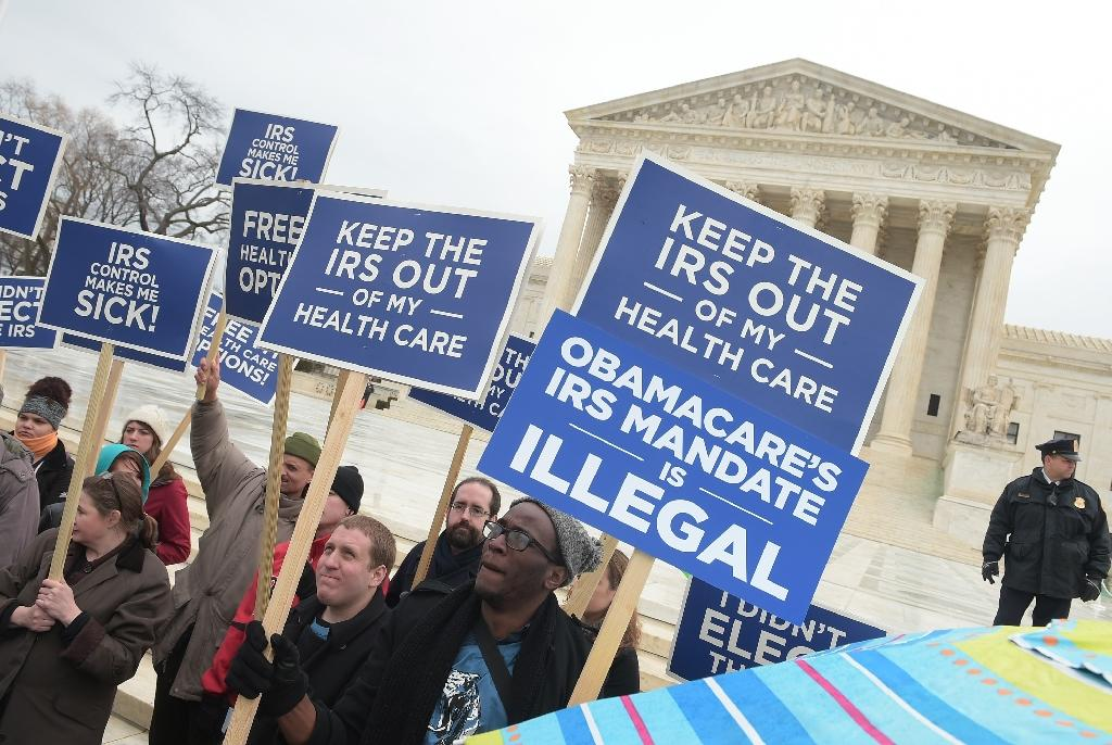 Divided US Supreme Court again weighs fate of 'Obamacare'
