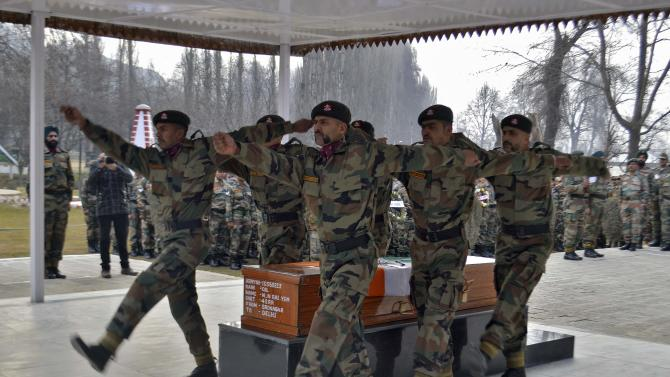 Indian soldiers march after placing a coffin that contains the body of army colonel Rai, who was killed in a gun battle with militants, during the wreath laying ceremony at a military garrison in Srinagar