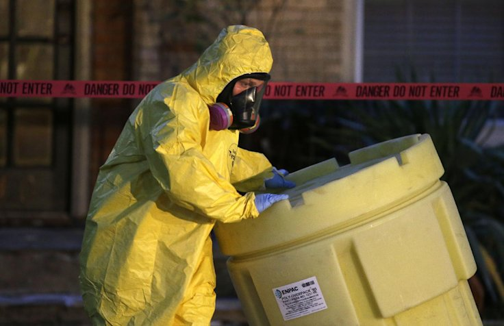 A hazmat worker outside the apartment building of a Dallas nurse on Oct. 12. (LM Otero/AP)