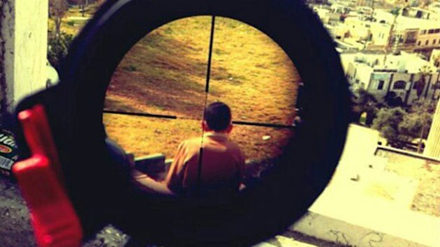Sniper Posts Pic of Child in Crosshairs (ABC News)