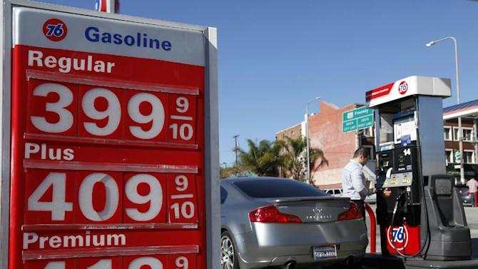 A man buys gas at a station Thursday Jan. 31, 2013 in Los Angeles. Gasoline prices are climbing as rising economic growth boosts oil prices and temporary refinery outages crimp gasoline supplies on the East and West Coasts. (AP Photo/Nick Ut)