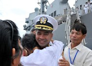 This US Navy handout image taken December 3, 2010 shows US Navy Cmdr. Michael V. Misiewicz being greeted by members of his family as USS Mustin arrives in Sihanoukville, Cambodia (AFP Photo/MC3 Devon Dow)