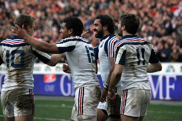 France's Rugby team players celebrate after France's Hugo Bonneval, right, scored a try, during their Six Nations rugby union international match against Italy, at the Stade de France, in Sain