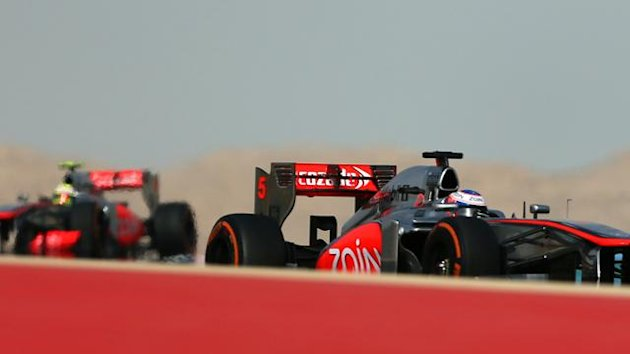 BAHRAIN, Manama : McLaren Mercedes' Mexican driver Sergio Perez (L) and McLaren Mercedes' British driver Jenson Button drive at the Bahrain International Circuit in Manama on April 21, 2013 during the Bahrain Formula One Grand Prix (AFP)