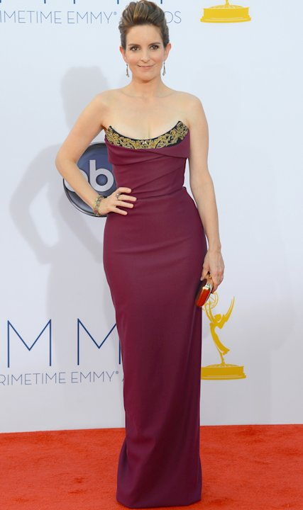 Emmys 2012: Tina Fey wows in a figure-hugging maroon dress.