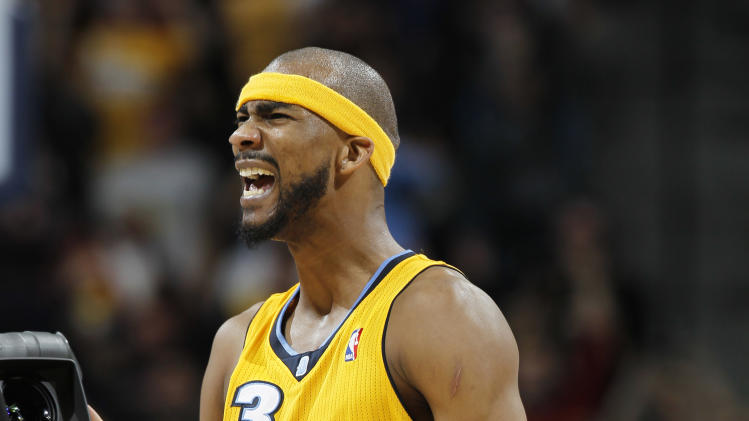 Denver Nuggets forward Corey Brewer reacts as time runs out in the fourth quarter of a 101-100 victory over the Philadelphia 76ers in an NBA basketball game in Denver, Thursday, March 21, 2013. (AP Photo/David Zalubowski)