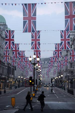 The Union Flags are hung along Regent Street in London in celebration of the forthcoming royal wedding between Prince William and Kate Middleton Tuesday, April 19, 2011.(AP Photo/PA, Carl Court) UNITED KINGDOM OUT, NO SALES, NO ARCHIVE