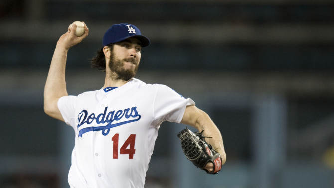 Los Angeles Dodgers' Dan Haren pitches against the San Francisco Giants during a baseball game, Monday, Sept. 22, 2014, in Los Angeles. The Giants won 5-2 in 13 innings. (AP Photo/The Orange County Register, Kevin Sullivan)
