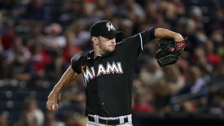 Miami Marlins starting pitcher Jarred Cosart (23) delivers a pitch in the eighth inning of a baseball game against the Atlanta Braves, Saturday, Aug. 30, 2014, in Atlanta. The Marlins won 4-0. (AP Photo/Jason Getz)