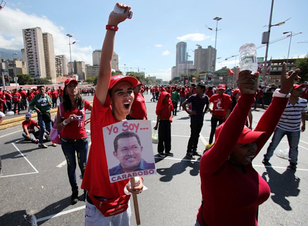 Supporters of Venezuela's President Hugo Chavez shout slogans during a rally in Caracas, Venezuela, Saturday, Jan. 26, 2013. Venezuelan President Hugo Chavez's condition has improved and he is now optimistic as he faces more treatment following cancer surgery, his vice president said Saturday. (AP Photo/Fernando Llano)
