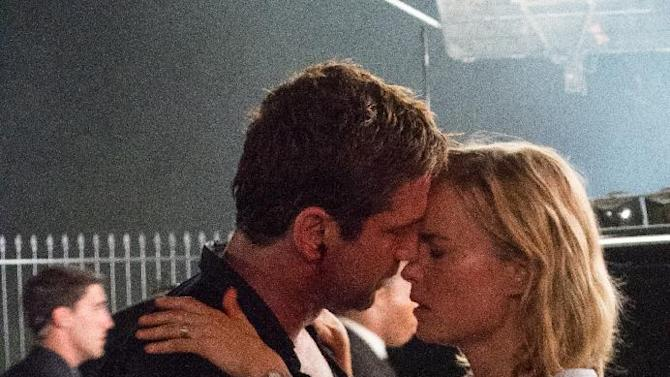 "This film image released by FilmDistrict shows Gerard Butler, left, and Radha Mitchell in a scene from ""Olympus Has Fallen."" (AP Photo/FilmDistrict, Phil Caruso)"