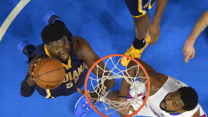 Indiana Pacers center Roy Hibbert, left, puts up a shot as Los Angeles Clippers center DeAndre Jordan defends during the first half of an NBA basketball game, Wednesday, Dec. 17, 2014, in Los Angeles.  The Clippers won 102-100. (AP Photo/Mark J. Terrill)