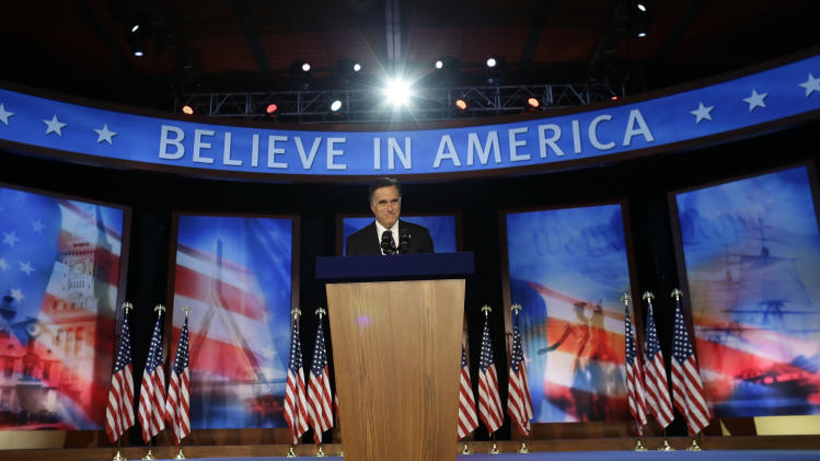 Republican presidential candidate and former Massachusetts Gov. Mitt Romney takes the podium to give his concession speech at his election night rally in Boston, Wednesday, Nov. 7, 2012. (AP Photo/Charles Dharapak)