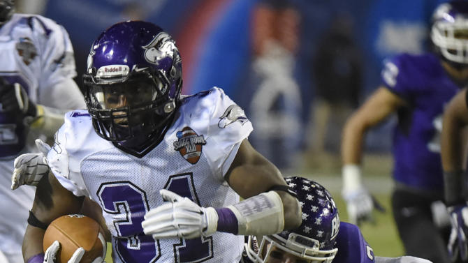 Wisconsin-Whitewater running back Dennis Moore (31) carries as Mount Union's Alex Kocheff pursues during the second half of the NCAA Division III championship college football game at Salem Stadium in Salem, Va., Friday, Dec. 19, 2014. (AP Photo/Don Petersen)