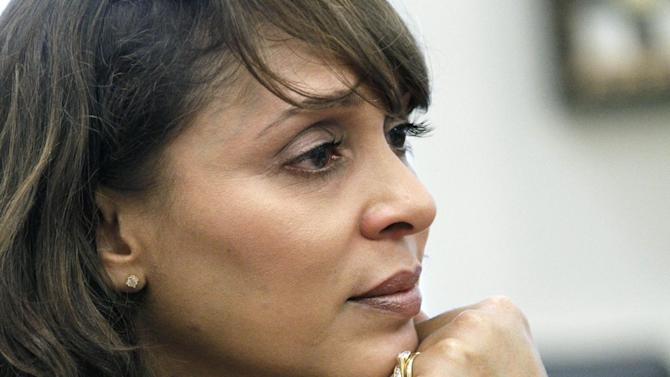 """FILE - In this Sept. 18, 2012 file photo U.S. Poet Laureate Natasha Trethewey is seen at Delta State University in Cleveland, Miss. Four major universities are joining theater companies in Boston, Baltimore, Washington and Atlanta in a project to commission new plays, music and dance compositions about the Civil War and its lasting legacy 150 years later. In Atlanta, Alliance Theatre and Emory will develop a new theatrical production of Trethewey's Pulitzer Prize-winning book """"Native Guard,"""" with a workshop planned for 2014. It recounts the story of a black Civil War regiment assigned to guard white Confederate soldiers on Ship Island off Mississippi's Gulf Coast. (AP Photo/Rogelio V. Solis, File)"""