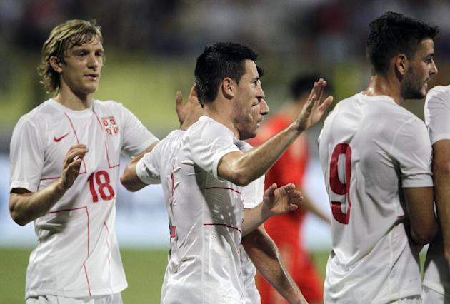 Serbian players celebrate after they score against Russia during a friendly match Dubai, United Arab Emirates, Friday Nov. 15, 2013