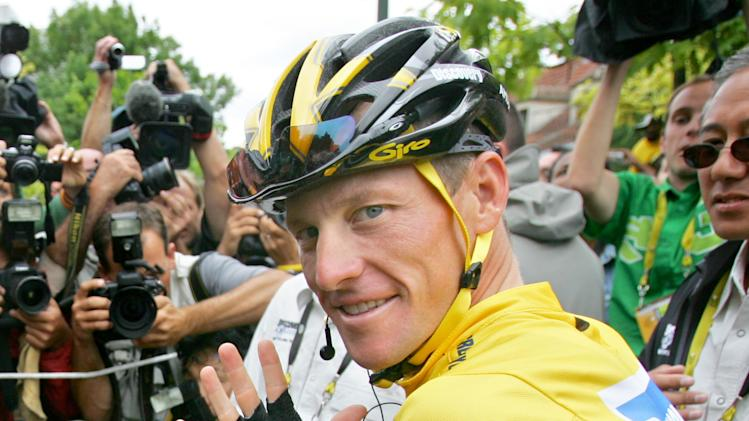 "FILE - In this July 24, 2005 file photo showing overall leader Lance Armstrong, of Austin, Texas, surrounded by press photographers, signaling seven, for his seventh straight win in the Tour de France cycling race, prior to the start of the 21st and final stage of the race, between Corbeil-Essonnes, south of Paris, and the French capital. After more than a decade of denying that he doped to win the Tour de France seven times, Armstrong was set to sit down Monday, Jan. 14, 2013, in Austin, Texas,  for what has been trumpeted as a ""no-holds barred,"" 90-minute, question-and-answer session with Oprah Winfrey.  (AP Photo/Peter Dejong, File)"