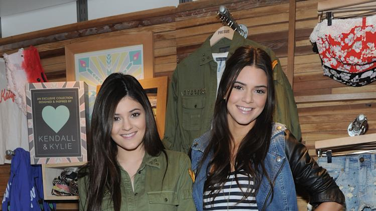 Kendall, right, and Kylie Jenner launch their exclusive Kendall & Kylie  collection during a public appearance at a PacSun store on Long Island, New York, Friday, February 8, 2013.   (Photo by Diane Bondareff/Invision for PacSun/AP Images)