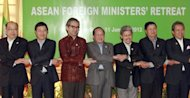 This file photo shows ASEAN foreign ministers posing for a picture during their previous official gathering in Siem Reap, Cambodia, in January. Southeast Asian and European foreign ministers began meeting in Brunei on Friday to chart a &quot;new chapter&quot; in their relations now that democratic reforms are under way in former pariah Myanmar