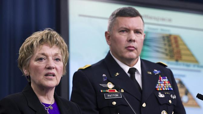 FILE - In this Feb. 9, 2012, file photo, Deputy Defense Undersecretary for Military Personnel Policy Vee Penrod, left, and Principal Director for Military Personnel Policy Maj. Gen. Gary Patton, speak at the Pentagon on the results of the department's Women in Service Review. If or when the Pentagon lets women become infantry troops,  the country's front-line warfighters, how many women will want to? The answer is probably not many. The Iraq and Afghanistan wars did change the face of combat and highlighted the need for women to play new roles and women already can be assigned to some combat arms jobs such as operating the Patriot missile system or field artillery radar, but offensive front-line fighting jobs will be the hardest nut to crack. Many believe women eventually could be in the infantry, but the Pentagon for years has been moving slowly on that front.  (AP Photo Manuel Balce Ceneta, File)