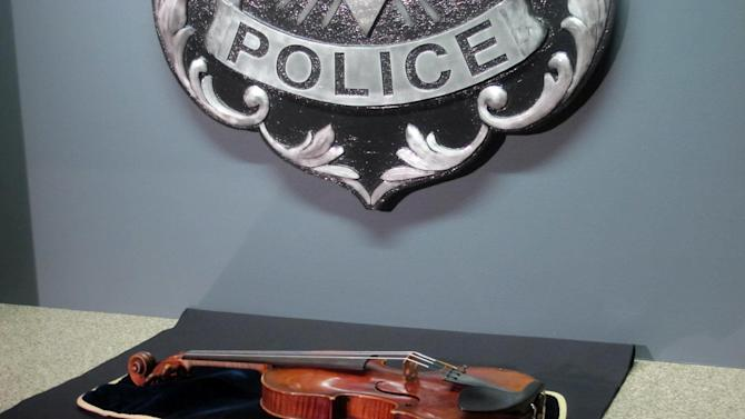 A $5 million Stradivarius violin is displayed at the Milwaukee Police Department Thursday, Feb. 6, 2014, in Milwaukee, a day after police recovered the instrument stolen on Jan. 27 from a concertmaster in a parking lot by a person wielding a stun gun. Police say the violin appears to be in good condition, and a Milwaukee County prosecutor said he planned to charge at least one suspect with felony robbery. (AP Photo/Dinesh Ramde)