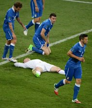 English forward Wayne Rooney (C) reacts at the end of regular time during the Euro 2012 football championships quarter-final match England vs Italy on June 24, at the Olympic Stadium in Kiev. The man regarded as the most gifted English footballer of his generation is running out of opportunities to prove that his dazzling debut at Euro 2004 was anything more than a teenage flash in the pan