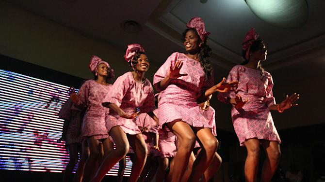 Contestants dance at the Lagos Carnival beauty pageant in Lagos, Nigeria, on Saturday, March 30, 2013. The pageant picked a queen for this year's Lagos Carnival, a festival that sees dancers fill the streets of Nigeria's largest city during Easter weekend.  (AP Photo/Jon Gambrell)