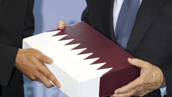 Sheikh Mohammed, chairman of the Qatar bid committee, submits the official bid book for the FIFA Soccer World Cup to FIFA President Blatter in Zurich