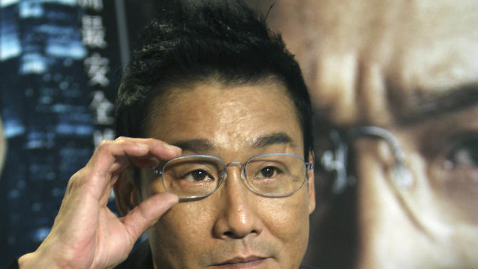 """In this photo taken on Monday, Nov. 12, 2012, Hong Kong actor Tony Leung Ka Fai speaks during an interview for his new film """"Cold War""""  in Taipei, Taiwan. (AP Photo/Chiang Ying-ying)"""