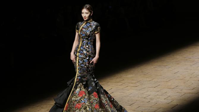 A model presents a creation by Chinese designer Zhang Zhifeng from 2014 NE TIGER Haute Couture Collection at China Fashion Week in Beijing