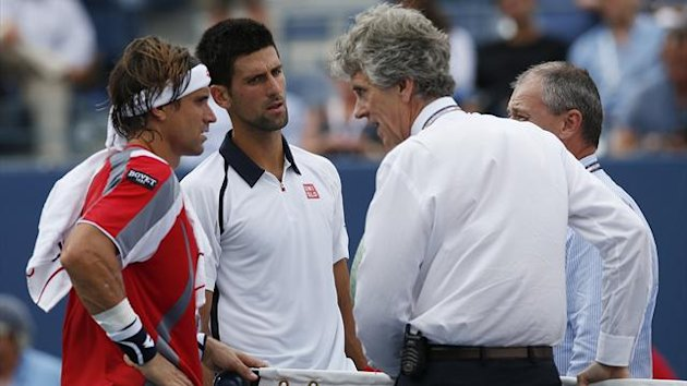 David Ferrer and Novok Djokovic are informed that their US Open semi-final is suspended due to expected bad weather