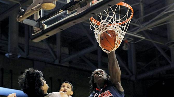 Arizona forward Angelo Chol (30) dunks as Colorado guards Sabatino Chen (23) and Andre Roberson defend in the first half of an NCAA college basketball game in Boulder, Colo., Thursday, Feb. 14, 2013. (AP Photo/David Zalubowski)
