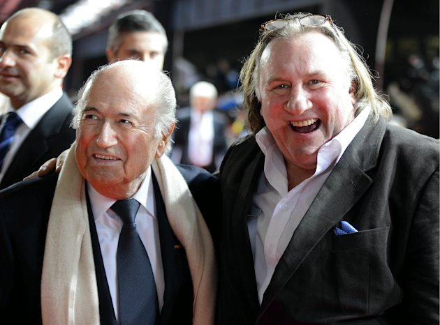 "<p>               FIFA President Joseph ""Sepp"" Blatter, left, and French-Russian actor Gerard Depardieu, right, arrive for the FIFA Ballon d'Or Gala 2013 held at the Kongresshaus in Zurich, Switzerland, on Monday, Jan. 7, 2013. French actor Gerard Depardieu has received a Russian passport after he  sought Russian citizenship as part of his battle against a proposed super tax on millionaires in France.  (AP Photo/Keystone/Walter Bieri)"