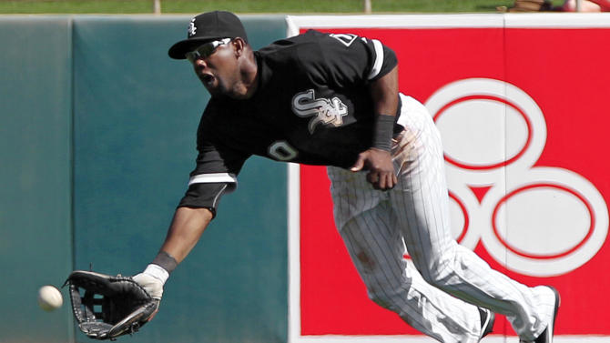 Chicago White Sox center fielder Alejandro De Aza dives but can't catch a single by Oakland Athletics' Kurt Suzuki in the fourth inning of a spring training baseball game, Monday, March 12, 2012, in Glendale, Ariz. (AP Photo/Mark Duncan)