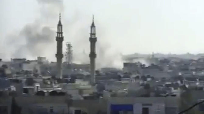 This image made from amateur video released by the Shaam News Network and accessed Tuesday, April 17, 2012, purports to show smoke rising from buildings in Homs, Syria. The Syrian regime widened shelling attacks on opposition strongholds Tuesday, activists said, targeting a second town in a new sign that a U.N.-brokered cease-fire is quickly unraveling despite the presence of foreign observers. (AP Photo/Shaam News Network via AP video) TV OUT, THE ASSOCIATED PRESS CANNOT INDEPENDENTLY VERIFY THE CONTENT, DATE, LOCATION OR AUTHENTICITY OF THIS MATERIAL