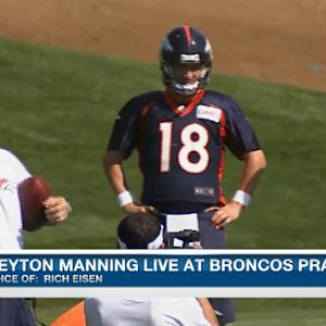 Denver Broncos quarterback Peyton Manning is back in action at training camp