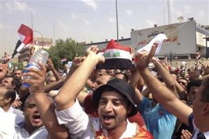 Protesters demand that the pensions of parliamentarians be cancelled during a demonstration in Baghdad