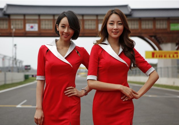 Grid girls pose on the grids prior to the South Korean F1 Grand Prix at the Korea International Circuit in Yeongam