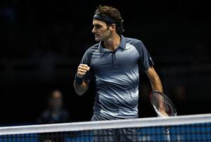 Federer of Switzerland celebrates winning the second set of his men's singles tennis match against Djokovic of Serbia at the ATP World Tour Finals at the O2 Arena in London