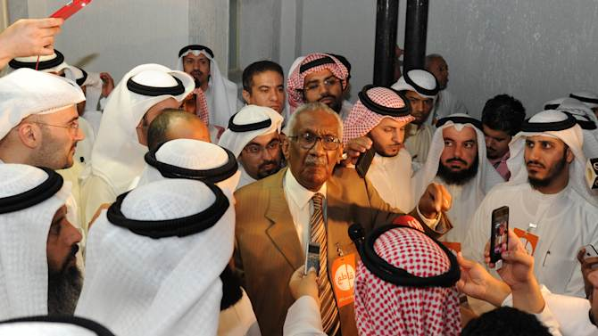 Kuwaiti opposition leader Ahmad al-Khateeb, center, talks to Kuwaiti citizens during a demonstration in Shuwaikh, Kuwait City, on Wednesday, Oct. 31, 2012. Anti-government groups have denounced the detention of former parliament member Musallam al-Barrack for allegedly insulting Kuwait's emir during protests. Parliament elections are planned for Dec 1..(AP Photo/Gustavo Ferrari)