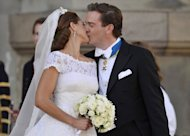Sweden's Princess Madeleine kisses her new husband Christopher O´Neill kiss outside the chapel on June 8, 2013 at the Royal Palace in Stockholm. Flag-waving Swedes and royals celebrated the marriage