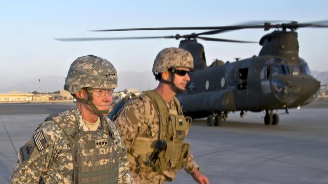 In this image released by the U.S. Department of Defense and taken Monday, Aug. 20, 2012, Army Gen. Martin E. Dempsey, chairman of the Joint Chiefs of Staff, prepares to board a CH-47 at Kabul International Airport in Kabul, Afghanistan. (AP Photo/D. Myles Cullen, Department of Defense)