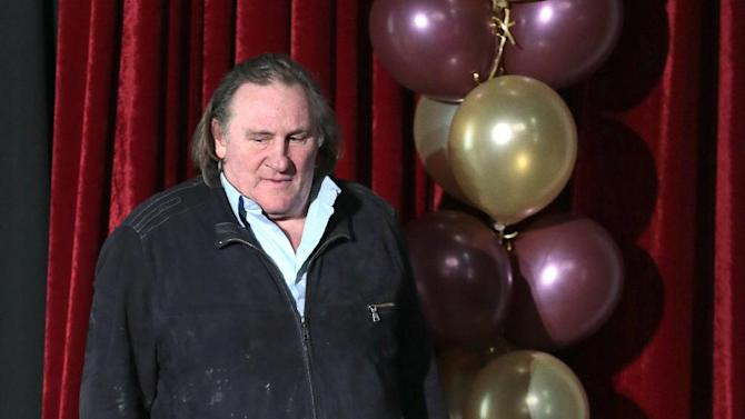French actor Gerard Depardieu speaks at the opening ceremony of the Illusion movie theater after its restoration in Moscow, Russia, Friday, Feb. 22, 2013. President Vladimir Putin granted Depardieu Russian citizenship last month and on Saturday he is set to get registered as a resident of the city of Saransk. (AP Photo/Mikhail Metzel)